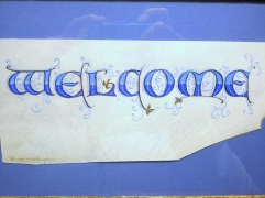 Versal letters by Renate, on vellum.l Black ink letters are filled with blue gouache hue and tint, overpainted with white.