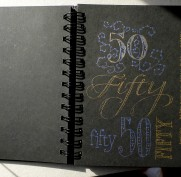 #50 Black paper and gel pens.